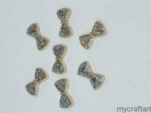 Silver bows- plastic 10psc