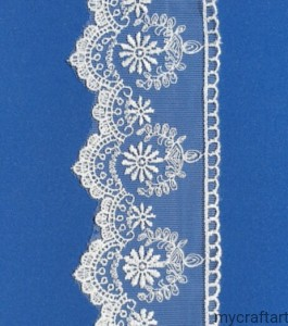 Cream lace on the tulle, width 7 cm